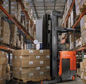 warehouse and totoyota reach truck forklift in warehouse aisleyota forklift