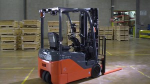 toyota three wheel electric forklift in warehouse