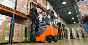 toyota four wheel electric forklift in warehouse