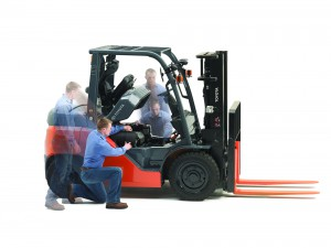 blurred toyota forklift technician with forklift