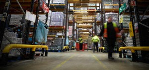 pedestrians forklift blurred warehouse racking