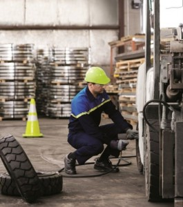 forklift tire tech at work