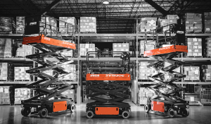 aichi scissor lift group inside warehouse black and white